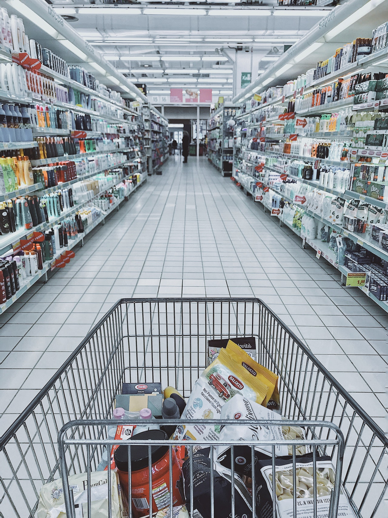Shopping cart filled with CPG brands.